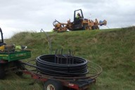 Moleploughing pipework around tee