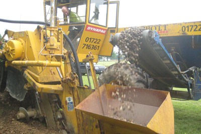 Dynapac Trencher installing lateral drainage pipe