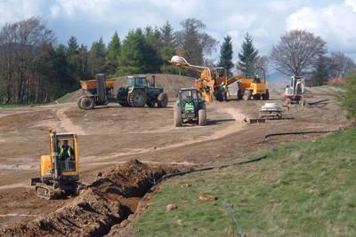 Installing drainage on 13th Hole