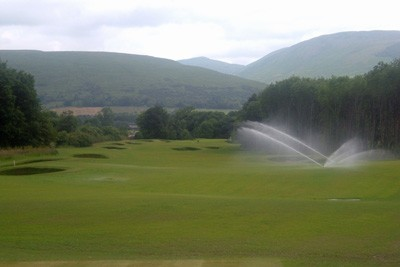 View down 8th Fairway with sprinklers operating
