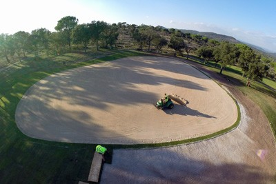 Preparing surface of new putting green and turfing surrounds