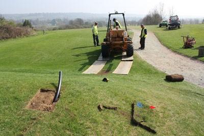 Moleploughing tee irrigation pipework