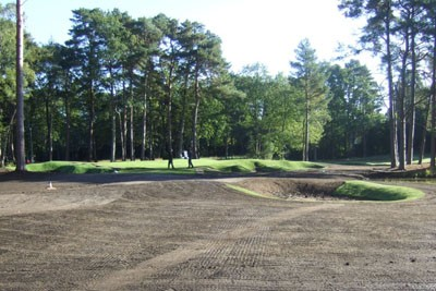 Completed green with partially completed new bunker in foreground
